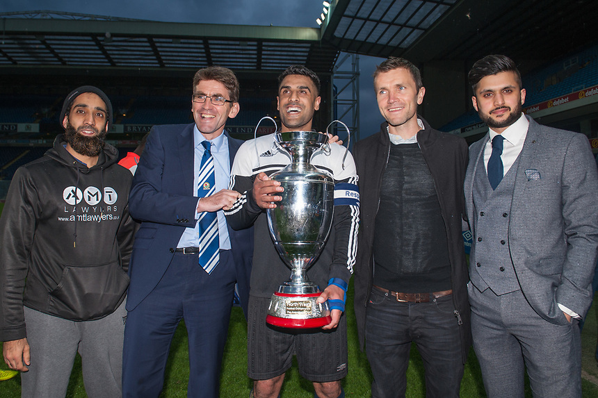 The Coppice United captain recieves the Asian Image cup from Blackburn Rovers coaching staff following the AMT Lawyers Asian Image Cup Final at Ewood Park, Blackburn on Friday 11th May 2018.