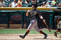 Gary Brown (21) of the Fresno Grizzlies at bat against the Salt Lake Bees at Smith's Ballpark on May 26, 2014 in Salt Lake City, Utah.  (Stephen Smith/Four Seam Images)