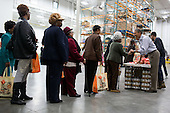 United States President Barack Obama talks with people as he and members of the Obama family participate in a service project at the Capital Area Food Bank in Washington, D.C., November 21, 2012. .Mandatory Credit: Pete Souza - White House via CNP
