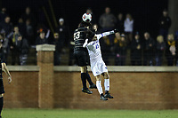 WINSTON-SALEM, NC - DECEMBER 07: Nico Benalcazar #23 of Wake Forest University and Thibault Candia #85 of the University of California Santa Barbara challenge for a header during a game between UC Santa Barbara and Wake Forest at W. Dennie Spry Stadium on December 07, 2019 in Winston-Salem, North Carolina.