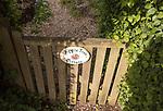 Gate sign for Apple Tree Cottage at village of Sandy Lane, Wiltshire, England, UK