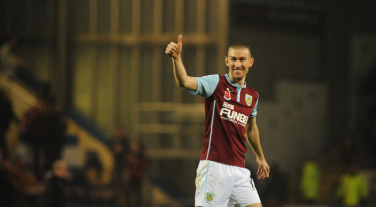 Burnley's David Jones celebrates the 1-0 win over Hull City<br /> <br /> Photographer Chris Vaughan/CameraSport<br /> <br /> Football - Barclays Premiership - Burnley v Hull City - Saturday 8th November 2014 - Turf Moor - Burnley<br /> <br /> &copy; CameraSport - 43 Linden Ave. Countesthorpe. Leicester. England. LE8 5PG - Tel: +44 (0) 116 277 4147 - admin@camerasport.com - www.camerasport.com