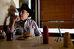 Kendrick Brinson.LUCEO..Dan Sumners, 65, lunches in Lonnie's Roadhouse, a diner alongside Highway 2 in Williston, North Dakota, January 2012. Williston is currently experiencing an influx of people relocating there for the town's third oil boom...Model Released: yes.Assigning Editor: Michael Wichita.