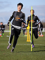 Pictured: Ki Sung Yueng Thursday 25 February<br /> Re: Swansea City FC training at Fairwood, near Swansea, Wales, UK, ahead of their game against Tottenham Hotspur.