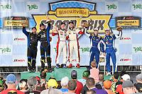 #52 MINI JCW Team, MINI JCW, ST: Mark Pombo, Colin Mullan, #21 Bodymotion Racing, Porsche Cayman, ST: Max Faulkner, Jason Rabe, #37 MINI JCW Team, MINI JCW, ST: Derek Jones, Nate Norenberg, celebrates the win in victory lane