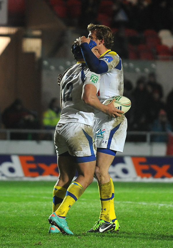 Clermont Auvergne's Aurelien Rougerie congratulates Clermont Auvergne's Benson Stanley after he scored the third try . - CREDIT - CameraSport - Ian Cook - ..Rugby Union - Heineken Cup Pool 5 - Scarlets v Clermont Auvergne - Saturday 19th January 2013 - Parc y Scarlets - Llanelli..© CameraSport - 43 Linden Ave. Countesthorpe. Leicester. England. LE8 5PG - Tel: +44 (0) 116 277 4147 - admin@camerasport.com - www.camerasport.com..