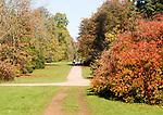 People walking along pathways in National arboretum, Westonbirt arboretum, Gloucestershire, England, UK