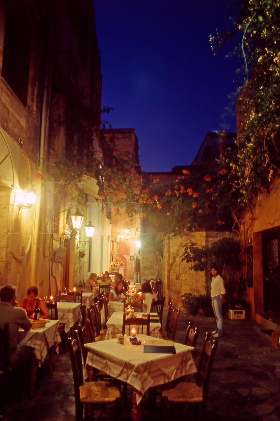 Typical Venetian Alleyway and Restaurants at night in Chania Old Town..Western Crete. Greece.