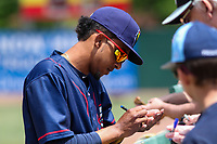 Cedar Rapids Kernels shortstop Wander Javier (15) signs autographs for fans prior to a Midwest League game against the Beloit Snappers on June 2, 2019 at Pohlman Field in Beloit, Wisconsin. Beloit defeated Cedar Rapids 6-1. (Brad Krause/Four Seam Images)