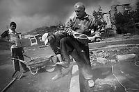"Nagorny-Karabach, 14.05.2011, Shushi. Arbeiter renovieren einen Strafle in Schuschi. ""The Twentieth Spring"" - ein Portrait der s¸dkaukasischen Stadt Schuschi, 20 Jahre nach der Eroberung der Stadt durch armenische K?mpfer 1992 im B¸gerkrieg um die Unabh?ngigkeit Nagorny-Karabachs (1991-1994). Labour at construction sites in Shushi. ""The Twentieth Spring"" - A portrait of Shushi, a south caucasian town 20 years after its ""Liberation"" by armenian fighters during the civil war for independence of Nagorny-Karabakh (1991-1994). .Travail sur les chantiers à Chouchi. ""Le Vingtieme Anniversaire"" - Un portrait de Chouchi, une ville du Caucase du Sud 20 ans après sa «libération» par les combattants arméniens pendant la guerre civile pour l'indépendance du Haut-Karabakh (1991-1994)..© Timo Vogt/Est&Ost, NO MODEL RELEASE !!"