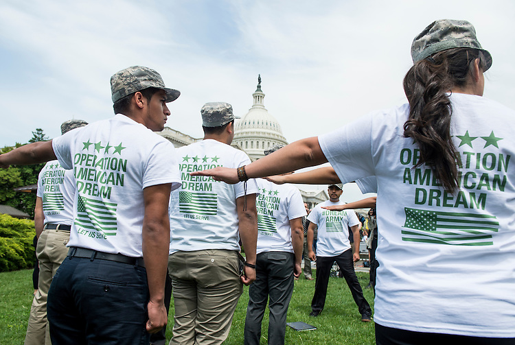 UNITED STATES - MAY 20: Undocumented youth get in military formation for the news conference on military service for undocumented youth with Deferred Action and other issues related to military service for immigrants and their families on Tuesday, May 20, 2014, out side of the U.S. Capitol. (Photo By Bill Clark/CQ Roll Call)