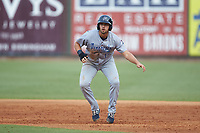Alex Kirilloff (19) of the Pensacola Blue Wahoos takes his lead off of first base against the Birmingham Barons at Regions Field on July 7, 2019 in Birmingham, Alabama. The Barons defeated the Blue Wahoos 6-5 in 10 innings. (Brian Westerholt/Four Seam Images)