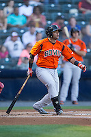 Rossmel Perez (14) of the Bowie Baysox follows through on his swing against the Richmond Flying Squirrels at The Diamond on May 23, 2015 in Richmond, Virginia.  The Baysox defeated the Flying Squirrels 3-2.  (Brian Westerholt/Four Seam Images)