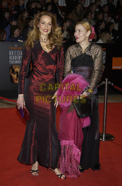 JERRY HALL (& SISTER?).Bafta Awards - British Academy Awards at Odeon Leicester Square.15 February 2004.full length, twin.www.capitalpictures.com.sales@capitalpictures.com.©Capital Pictures
