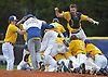 Jonah Katz #9, Kellenberg catcher, top right, leaps atop the pile of celebrating teammates after the Firebirds' 1-0 win over St. John the Baptist in the Nassau-Suffolk CHSAA varsity baseball championship at Hofstra University on Monday, May 29, 2017.