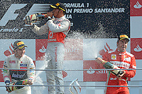 09.09.2012. Monza, Italy.  Race winner British Formula One driver Lewis Hamilton (C) of McLaren Mercedes, 2nd Mexican Sergio Perez (L) of Sauber and 3rd Spanish Fernando Alonso of Ferrari celebrate with champagne on the podium of the 2012 Italian Formula One Grand Prix at the race track Autodromo Nazionale Monza, Italy
