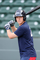 Kevin Mager (24) of the Greenville Drive waits to take batting practice before a game against the Kannapolis Intimidators on Friday, April 11, 2014, at Fluor Field at the West End in Greenville, South Carolina. Greenville won, 13-2. (Tom Priddy/Four Seam Images)