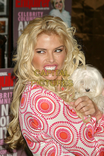 ANNA NICOLE SMITH.Signs autographs at the re-launch of The National Enquirer Hudson News in Grand Central Station, New York City, USA, April 7th 2005..portrait headshot mouth open teeth holding small white dog pet animal teeth.Ref: IW.www.capitalpictures.com.sales@capitalpictures.com.©Ian Wilson/Capital Pictures.