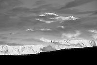 Mount McKinley rises 20,320' above a ridge near Wonder Lake with late evening summer light illuminating the maassif.  Denali National Park, Alaska.