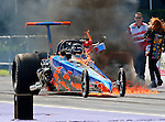 Top Dragster driver Kyle Dvorak (305K) in his 94 Spitzer dragster, blows a fuel line off his engine which catches fire during the ADRL World Finals IX drag races which were held at the Royal Purple Raceway in Baytown, Texas.