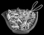 X-ray image of tossed salad with tongs (white on black) by Jim Wehtje, specialist in x-ray art and design images.