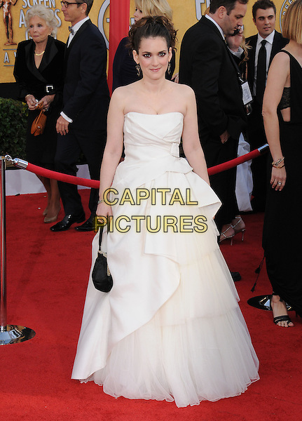 WINONA RYDER .at the 17th Screen Actors Guild Awards held at The Shrine Auditorium in Los Angeles, California, USA, .January 30th 2011..SAG Sags arrivals full length white dress cream strapless gown long maxi tiered ruffle folded layered black bag bracelet .CAP/RKE/DVS.©DVS/RockinExposures/Capital Pictures.