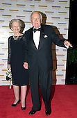 "Walter Cronkite and his wife, Mary, arrive at the Harry S. Truman Building (Department of State) in Washington, D.C. on December 4, 2004 for a dinner hosted by United States Secretary of State Colin Powell.  At the dinner six performing arts legends will receive the Kennedy Center Honors of 2004.  This is the 27th year that the honors have been bestowed on ""extraordinary individuals whose unique and abundant artistry has contributed significantly to the cultural life of our nation and the world"" said John F. Kennedy Center for the Performing Arts Chairman Stephen A. Schwarzman.  The award recipients are: actor, director, producer, and writer Warren Beatty; husband-and-wife actors, writers and producers Ossie Davis and Ruby Dee; singer and composer Elton John; soprano Joan Sutherland; and composer and conductor John Williams.<br /> Credit: Ron Sachs / CNP"