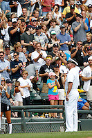 "Chicago White Sox crowd giving a standing ovation to the ""Hero of the Day"" during a game against the Kansas City Royals at U.S. Cellular Field on August 14, 2011 in Chicago, Illinois.  Chicago defeated Kansas City 6-2.  (Mike Janes/Four Seam Images)"