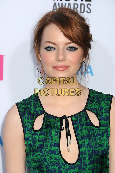 Emma Stone.17th Annual Critics Choice Movie Awards - Arrivals held at the Hollywood Palladium,  Los Angeles, California, USA, 12th January 2012..arrivals portrait headshot green print sleeveless cut out  blue hoop earrings make-up eyeliner .CAP/ADM/BP.©Byron Purvis/AdMedia/Capital Pictures.