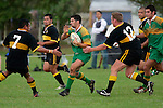Drury left wing S. Fogrewici has the attention of both S. Kotoa & C. McRobbie.  Counties Manukau Premier Club Rugby, Drury vs Bombay played at the Drury Domain, on the 14th of April 2006. Bombay won 34 - 13.
