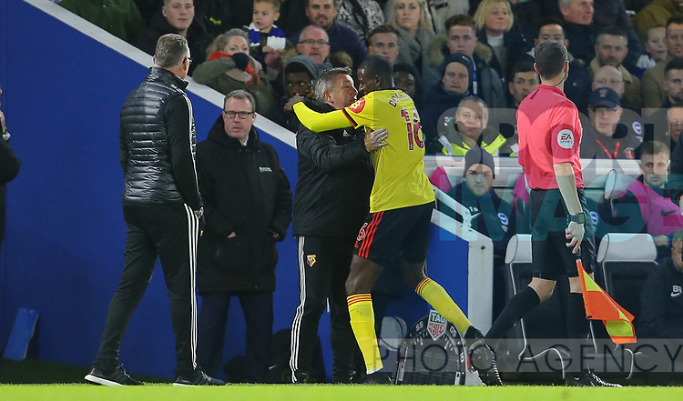 Watford's Abdoulaye Doucoure celebrates with assistant head coach Craig Shakespeare after scoring the opening goal during the Premier League match at the American Express Community Stadium, Brighton and Hove. Picture date: 8th February 2020. Picture credit should read: Paul Terry/Sportimage
