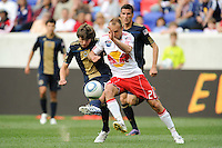 Joel Lindpere (20) of the New York Red Bulls challenges Jack McInerney (19) of the Philadelphia Union for the ball. The New York Red Bulls defeated the Philadelphia Union 2-1 during a Major League Soccer (MLS) match at Red Bull Arena in Harrison, NJ, on April 24, 2010.