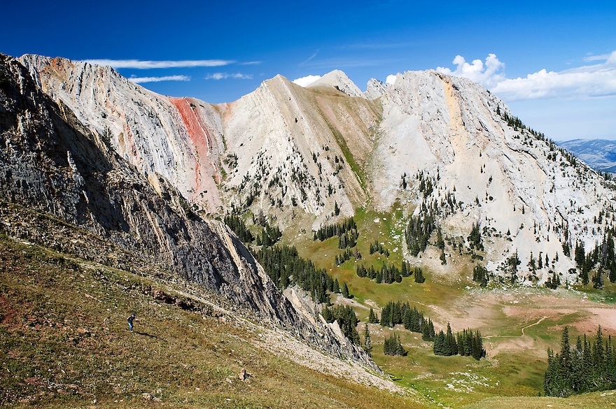 A hiker descends a slope in Frazier Basin in the Bridger Mountains near Bozeman, Montana.