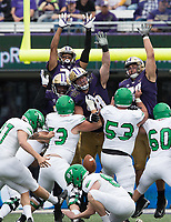 The Huskies sky to try and block a field goal attempt. The kick sailed wide right.