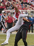 San Francisco 49ers inside linebacker Michael Wilhoite (57) tackles Arizona Cardinals wide receiver Larry Fitzgerald (11) on Thursday, October 06, 2016 at Levis Stadium in Santa Clara, California. The Cardinals defeated the 49ers 33-21.