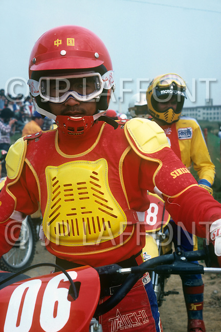 October, 1980. Suzuka, Japan. Motorcycle Riders gather in a motocross park in Suzuka.