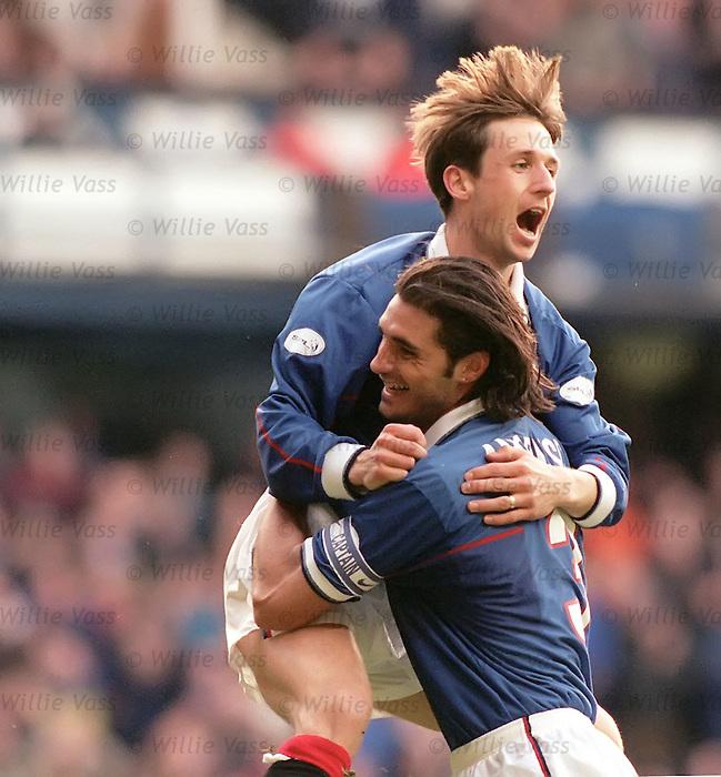 Neil McCann scores for Rangers and celebrates with Lorenzo Amoruso