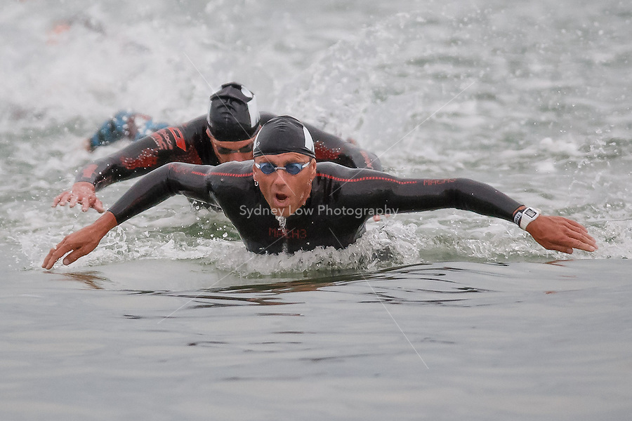 BENJAMIN SANSON (FRA) is first out of the water at the end of the swim leg of the swim leg of the IRONMAN Asia-Pacific Championship in Melbourne, Australia on Sunday March 23, 2014. (Photo Sydney Low / sydlow.com)