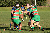 Courtney Roberts tries to fend off Calipoli as he is tackled by Michael Raaymakers. Counties Manukau Premier Club Rugby game between Onewhero and Waiuku, played at Onewhero on Saturday May 26th 2018. Onewhero won the game 24 - 20 after leading 17 - 12 at halftime. <br /> Onewhero Silver Fern Marquees 24 -Vaughan Holdt, Filipe Pau, Sean Bagshaw tries, Rhain Strang 3 conversions, Rhain Strang penalty.<br /> Waiuku Brian James Contracting 20 - Christian Walker, Fuifatu Asomua, Aaron Yuill tries, Christian Walker conversion, Christian Walker penalty .<br /> Photo by Richard Spranger.