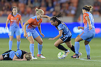 Vanessa DiBernardo (10) of the Chicago Red Stars attempts to dribble around Ellie Brush and Amber Brooks (12) of the Houston Dash in the first half while Alyssa Mautz (4) of the Chicago Red Stars lies on the ground after colliding with a Houston Dash player on Saturday, April 16, 2016 at BBVA Compass Stadium in Houston Texas.
