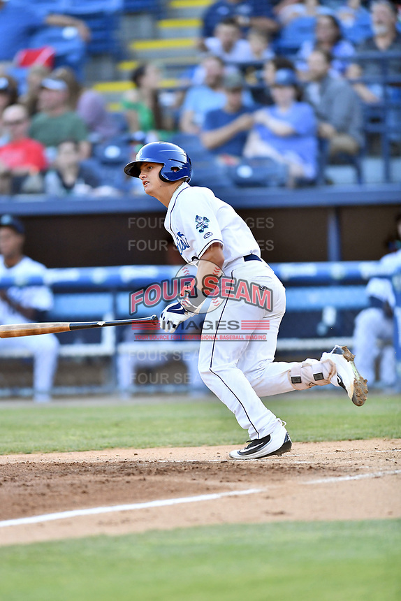 Asheville Tourists catcher Austin Bernard (2) swings at a pitch during a game against the Greensboro Grasshoppers at McCormick Field on May 10, 2018 in Asheville, North Carolina. The Tourists defeated the Grasshoppers 14-10. (Tony Farlow/Four Seam Images)