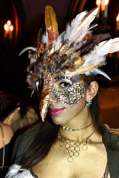 Golden bird costume at a Halloween party.