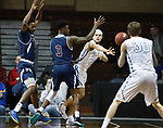 SIOUX FALLS, SD - MARCH 9:  Erich Erdman #24 of Briar Cliff passes to teammate Josh Belling #30 as Darwin Trotman #3 of St. Thomas defends at the 2018 NAIA DII Men's Basketball Championship at the Sanford Pentagon in Sioux Falls. (Photo by Dick Carlson/Inertia)