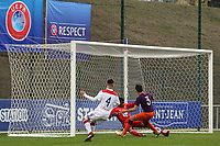 Olympique Lyonnais goalkeeper, Malcolm Barcola, somehow manages to prevent Manchester City's Eric Garcia from scoring during Lyon Under-19 vs Manchester City Under-19, UEFA Youth League Football at Groupama OL Academy on 27th November 2018
