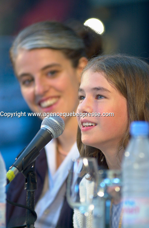 August 29,  2002, Montreal, Quebec, Canada<br /> <br /> <br /> Anne Wild, Film Maker  (L) and 11 year actress<br /> Henriette Confurius (R) , during the press conference for  Wild's movie<br /> MEIN ERSTES WUNDER (My First Miracle), presented in the official competitionof the 26th World Film Festival, August 29, 2002<br /> Born in Offenburg, Germany in 1967, Anne Wild studied literature, philosophy and art history at the University of Freiburg and acting at the Academy of Music and Applied Arts in Stuttgart. In the mid-1990s she worked in advertising in Hamburg and Berlin, then studied screenwriting and directing. Since 1997 she has worked as a freelance journalist for newspapers, radio and television. She wrote the script for WAS TUN, WENN'S BRENNT? (2002) and directed Afternoon in Siedlisko (2000) and Ballett ist ausgefallen (2001). MY FIRST MIRACLE marks her directorial debut in features. <br /> , LUCIE AUBRAC (Claude Berri, 1997), THE COMEDIAN HARMONISTS (Joseph Vilsmaier, 1997), and two by Tom Tykwer, WINTERSLEEPERS (1997) and RUN, LOLA, RUN (1998). He starred in Roland Suso Richter's hit film THE TUNNEL (2001), winner of the audience award at last year's Montreal World Film Festival, and his most recent film, THE SEAGULL'S LAUGHTER, is also showing at this year's Festival. He represents the new wave of german actors. <br /> <br /> <br /> Mandatory Credit: Photo by Pierre Roussel- Images Distribution. (&copy;) Copyright 2002 by Pierre Roussel <br /> <br /> NOTE : <br />  Nikon D-1 jpeg opened with Qimage icc profile, saved in Adobe 1998 RGB<br /> .Uncompressed  Uncropped  Original  size  file availble on request.