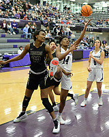 Fayetteville's Coriah Beck (14) reaches to score Friday, Jan. 17, 2020, over Bentonville's Maryam Dauda (left) during the first half of play in Bulldog Arena in Fayetteville. Visit nwaonline.com/prepbball/ for a gallery from the games.<br /> (NWA Democrat-Gazette/Andy Shupe)