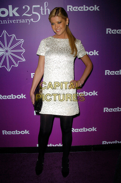 "TARA REID.At the Reebok 25th anniversary celebration of ""The Freestyle"" at Culture Club, New York, New York, USA,.21 February 2007..full length white tunic dress black clutch bag tights Christian Louboutin heels shoes hand on hip.CAP/ADM/BL.©Bill Lyons/AdMedia/Capital Pictures. *** Local Caption ***"