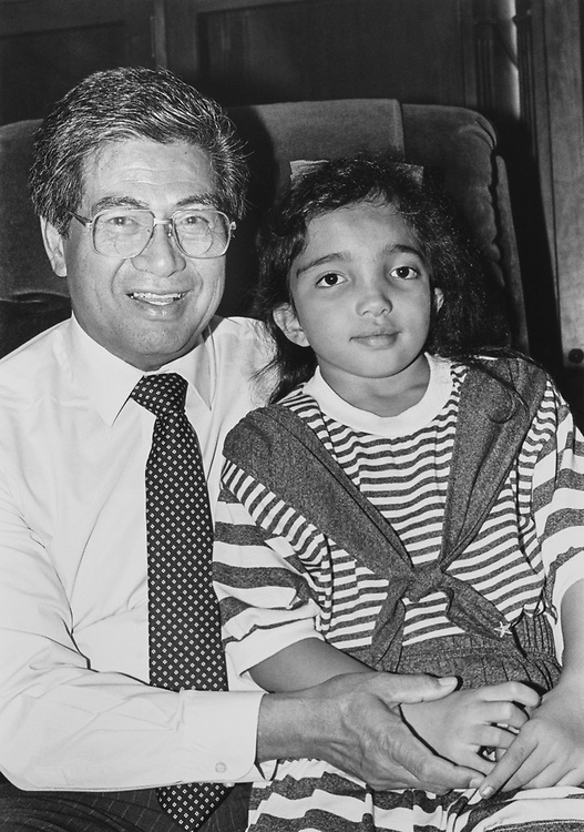 Sen. Daniel Akaka, D-Hawaii, and granddaughter Erin Mattson (age 7) relax for a moment  on May 17, 1990. (Photo by Laura Patterson/CQ Roll Call via Getty Images)