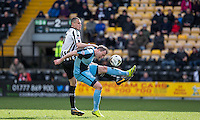 Garry Thompson of Wycombe Wanderers & Haydn Hollis of Notts County go in for the ball during the Sky Bet League 2 match between Notts County and Wycombe Wanderers at Meadow Lane, Nottingham, England on 28 March 2016. Photo by Andy Rowland.