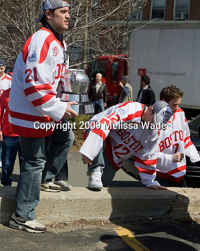 Jason Lawrence (BU - 21), Chris Connolly (BU - 12), Victor Saponari (BU - 17) - Boston University celebrated the Terrier's men's hockey national championship win with a parade starting from a parking lot at Commonwealth Avenue and Deerfield running to BU's Marsh Plaza where the Terriers were honored on stage before mingling with the fans.